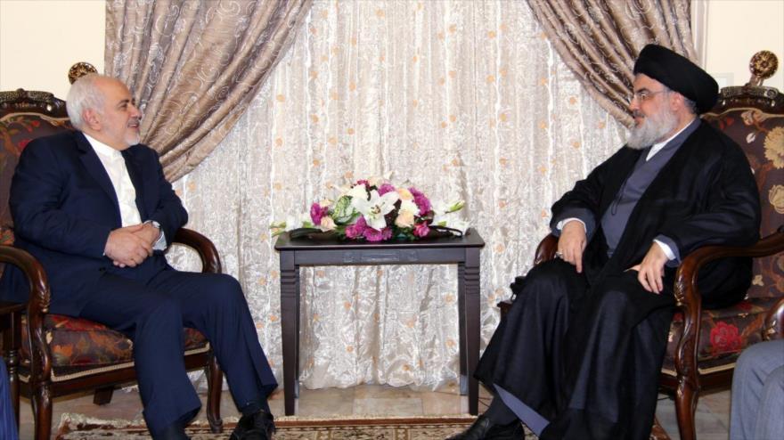 El canciller iraní, Mohamad Yavad Zarif (izda.), y el líder de Hezbolá, Seyed Hasan Nasralá, en Beirut, 11 de febrero de 2019. (Foto: AFP)
