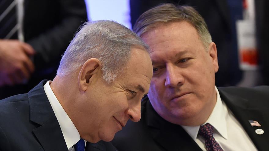 El premier israelí, Benjamín Netanyahu, (izq.) y el secretario de Estado de EE.UU., Mike Pompeo, Varsovia, 14 de febrero de 2019. (Foto: AFP)