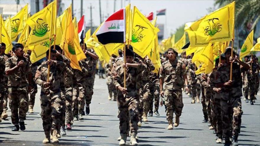 Miembros de Harakat Hezbolá Al-Nuyaba en un desfile militar en Irak.