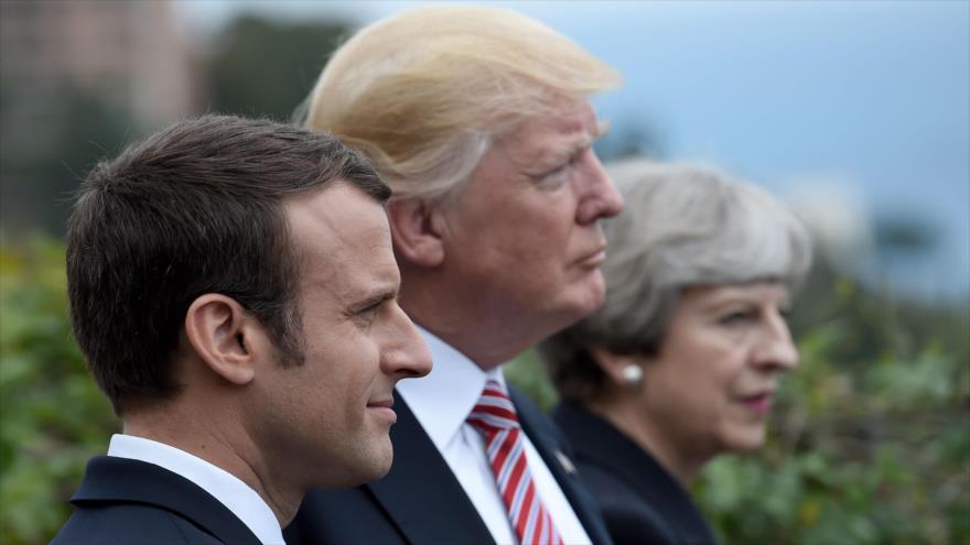 De izq. a dcha.: El mandatario de Francia, Emmanuel Macron, el presidente de EE.UU., Donald Trump, y la primera ministra del Reino Unido, Theresa May.