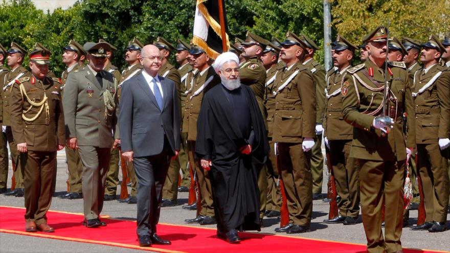 A diferencia de Trump, Rohani visita Irak a plena luz del día