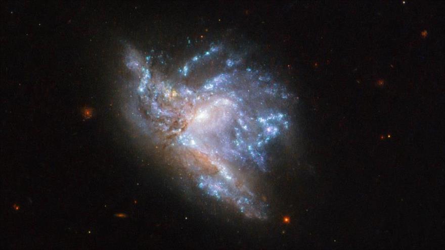 NGC 6052, dos galaxias en colisión en la constelación de Hércules, 8 de marzo de 2019. (Foto: NASA)
