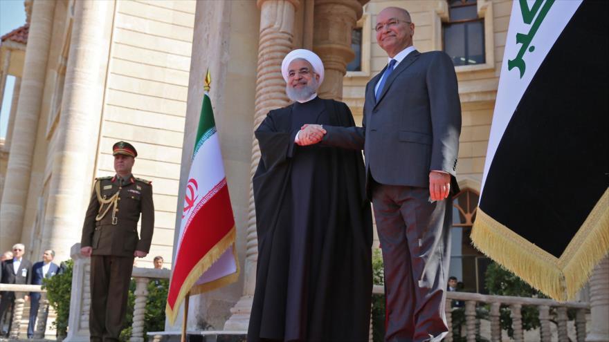 El presidente de Irán, Hasan Rohani (izq.), y su par iraquí, Barham Salih, Bagdad, capital de Irak, 11 de marzo de 2019. (Foto: AFP)