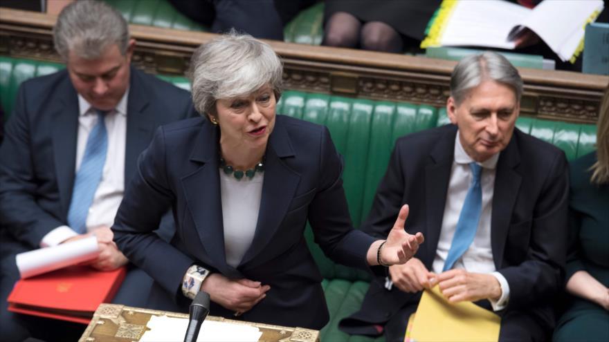 La primera ministra británica, Theresa May (centro), durante la votación en el Parlamento sobre el Brexit, 13 de marzo de 2019. (Fuente: AFP)