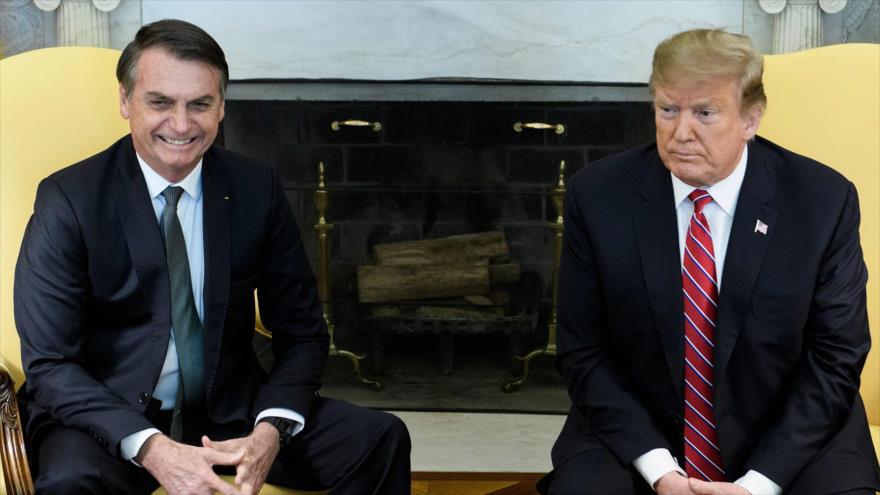 El presidente de EE.UU., Donald Trump (dcha.), se reúne con su par brasileño, Jair Bolsonaro, en la Casa Blanca, 19 de marzo de 2019. (Foto: AFP)