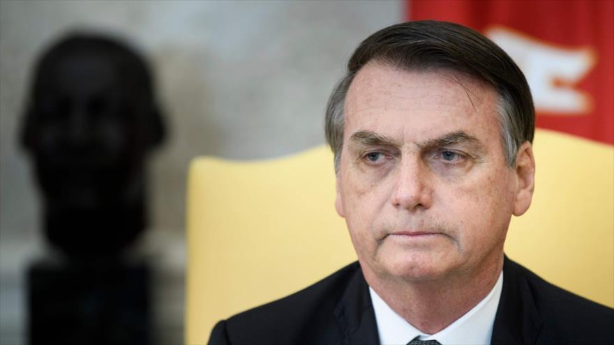 El presidente de Brasil, Jair Bolsonaro, espera una reunión con su par estadounidense, Donald Trump, en la Casa Blanca, 19 de marzo de 2019. (Foto: AFP)
