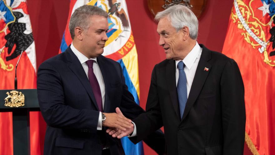 Los presidentes de Chile y Colombia, Sebastián Piñera (dcha.) e Iván Duque, respectivamente, Santiago, 21 de marzo de 2019. (Foto: AFP)