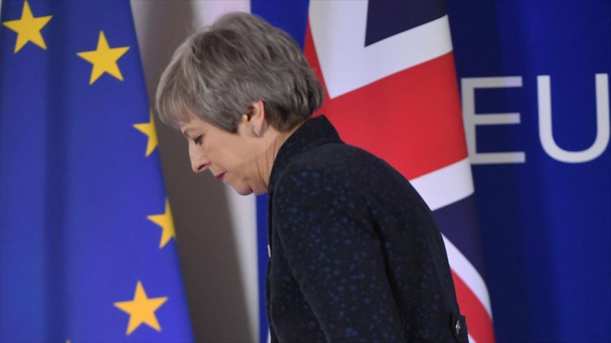 La primera ministra británica, Theresa May, tras una conferencia de prensa, 22 de marzo de 2019. (Foto: AFP)