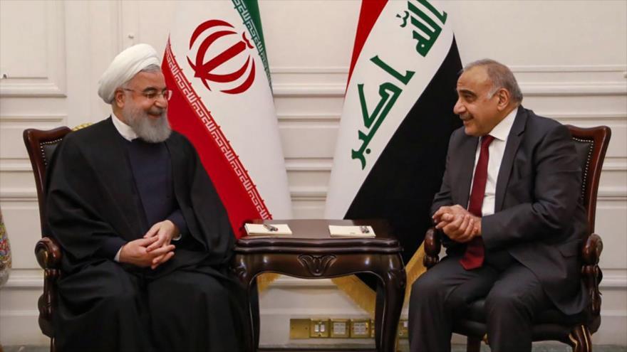 El presidente iraní, Hasan Rohani (izda.), junto al primer ministro iraquí, Adel Abdul-Mahdi, en Bagdad, 11 de marzo de 2019. (Foro: AFP)