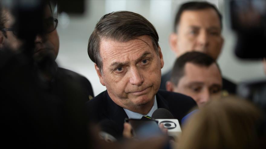 El presidente de Brasil, Jair Bolsonaro, ante los periodistas en el Palacio Planalto (Brasilia, la capital federal del Brasil), 12 de marzo de 2019. (Foto: AFP)
