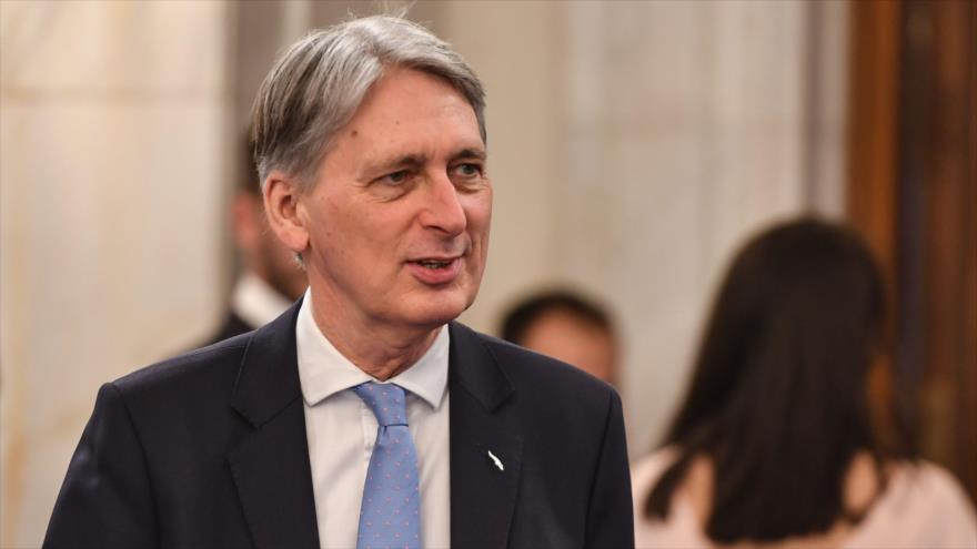 El ministro de Finanzas británico, Philip Hammond, durante un acto en Bucarest (capital rumana), 5 de abril de 2019. (Foto: AFP)