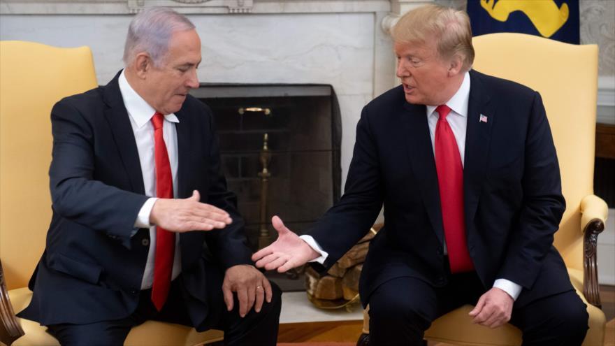 El primer ministro de Israel, Benjamín Netanyahu (izda.), se reúne con el presidente de EE.UU., Donald Trump, en la Casa Blanca, 25 de marzo de 2019. (Foto: AFP)
