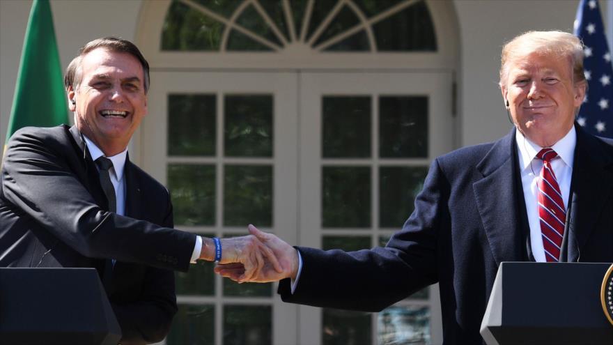 El presidente de EE.UU., Donald Trump (dcha.), y su par de Brasil, Jair Bolsonaro, en la Casa Blanca, 19 de marzo de 2019. (Foto: AFP)