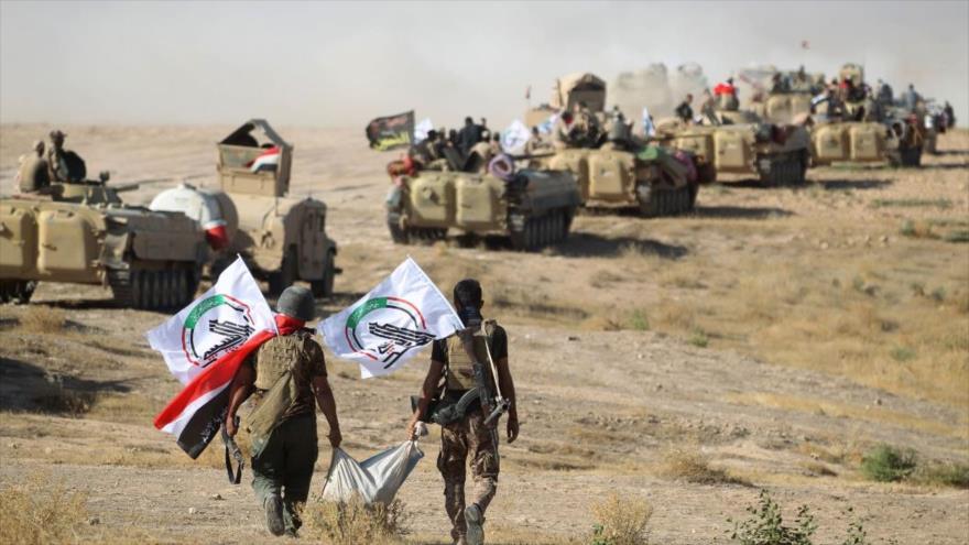 Los combatientes de Al-Hashad Al-Shabi durante una operación contra el grupo terrorista Daesh en Mosul, 22 de agosto de 2017. (Foto: AFP)