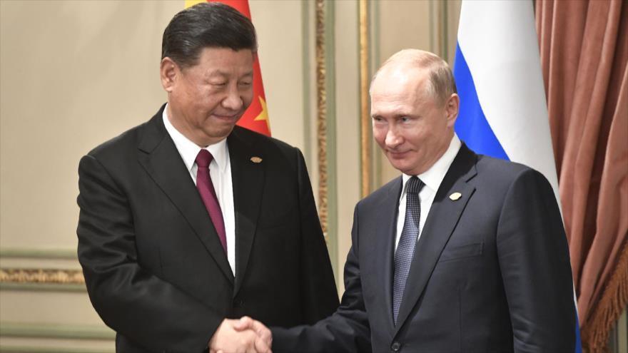 Los presidentes de Rusia y China, Vladimir Putin (drcha.) y Xi Jinping, respectivamente, Buenos Aires, 30 de noviembre de 2018. (Foto: AFP)