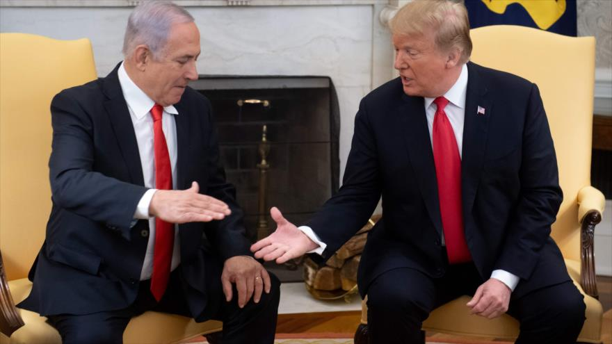 El presidente de EE.UU., Donald Trump, (dcha.), y el primer ministro israelí, Benjamín Netanyahu, en la Casa Blanca en Washington, DC., 25 de marzo de 2019. (Foto: AFP)