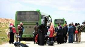 Desplazados sirios llegan a zonas en poder del Gobierno en Homs