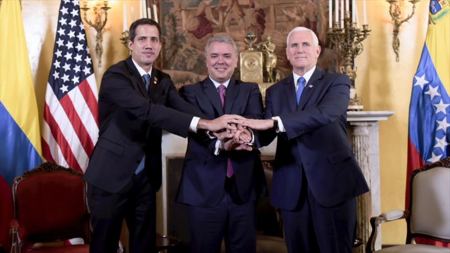 El venezolano Juan Guaidó (izq.); el presidente colombiano, Iván Duque; y el vicepresidente de EE.UU., Mike Pence, 25 de febrero de 2019. (Foto: AFP)