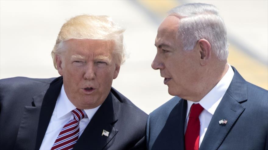 El presidente de EE.UU., Donald Trump (izda.), y el premier israelí, Benjamín Netanyahu, Tel Aviv, 21 de marzo de 2019. (Foto: AFP)