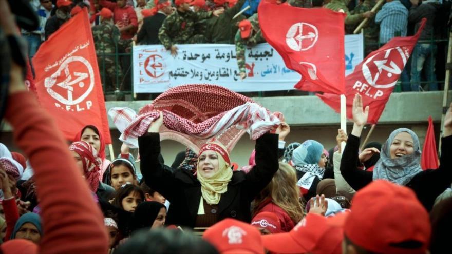 Simpatizantes del Frente Democrático por la Liberación de Palestina (FDLP) durante una concentración palestina.
