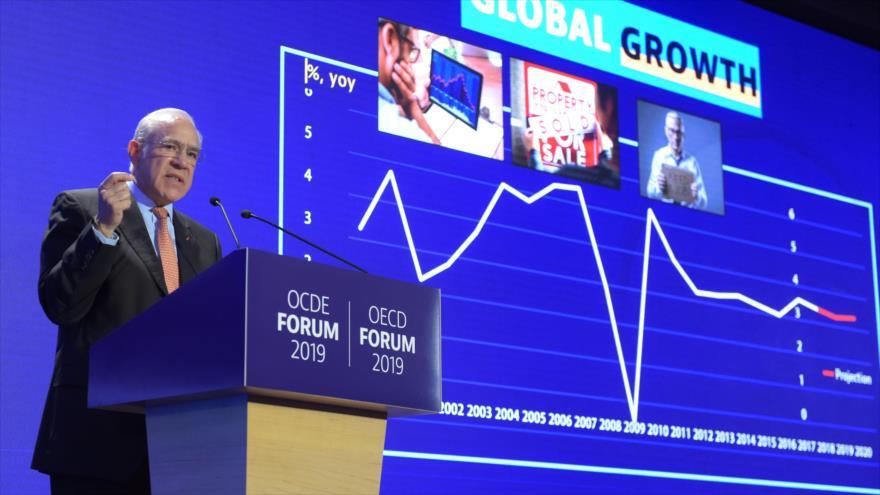 El secretario general de la OCDE, Angel Gurria, presenta un informe de la organización, París, 21 de mayo de 2019. (Foto: AFP)