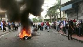 Hondureños cumplen un mes de protestas en las calles