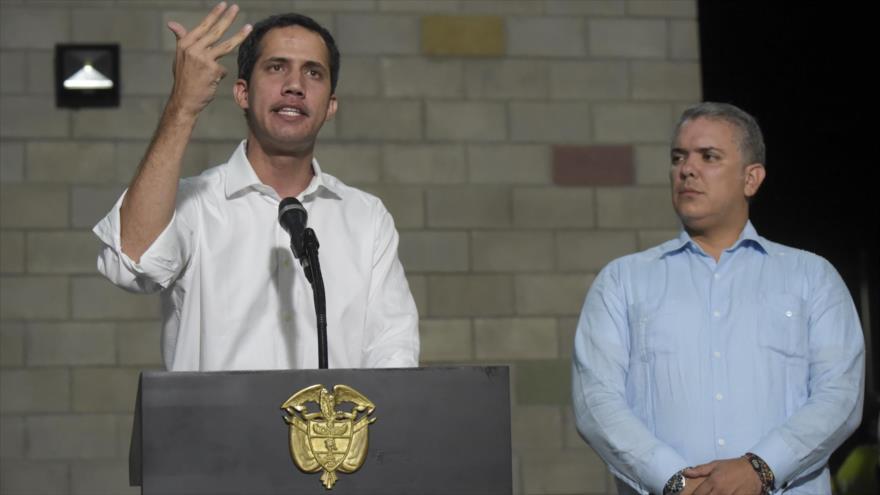 El líder golpista venezolano Juan Guaidó (izda.) y el presidente colombian, Iván Duque, Cúcuta, 23 de febrero de 2019. (Foto: AFP)