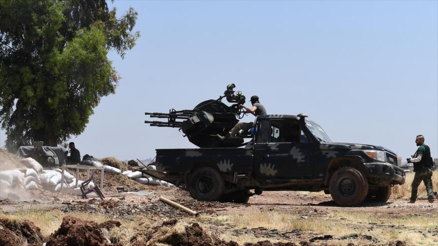 Vean cómo un cohete del Ejército sirio impacta contra terroristas