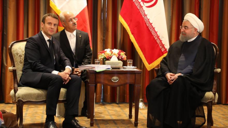 El presidente de Irán, Hasan Rohani (dcha.), en una reunión en Nueva York con su par francés, Emmanuel Macron, 18 de septiembre de 2017. (Foto: AFP)