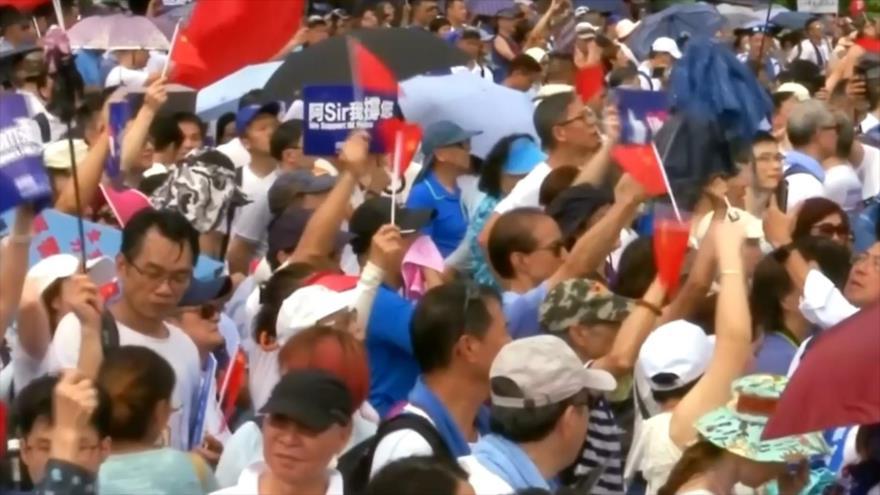 Miles se manifiestan en apoyo a la Policía en Hong Kong | HISPANTV