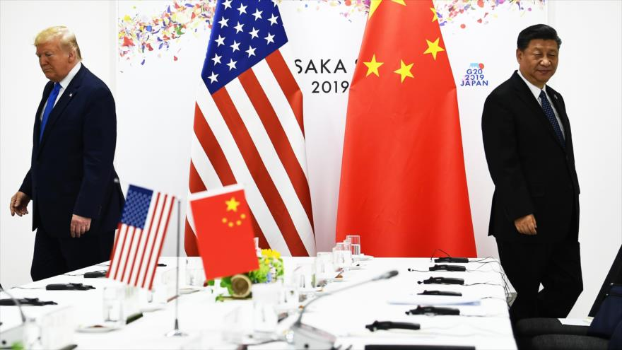El presidente de China, Xi Jinping (dcha.), y su par de EE.UU., Donald Trump, se reúnen en Osaka (Japón), 29 de junio de 2019. (Foto: AFP)