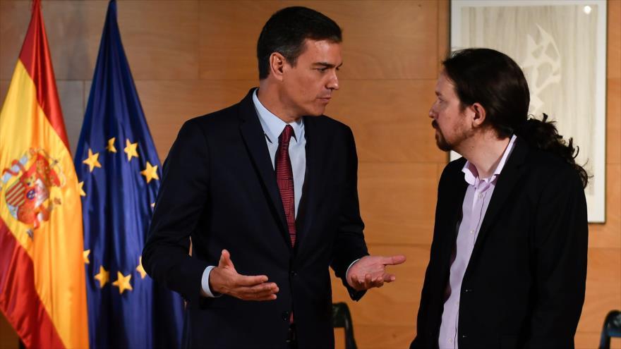 El presidente del Gobierno español, Pedro Sánchez (izda.), y el líder de Unidas Podemos, Pablo Iglesias, en Madrid, 9 de julio de 2019. (Foto: AFP)