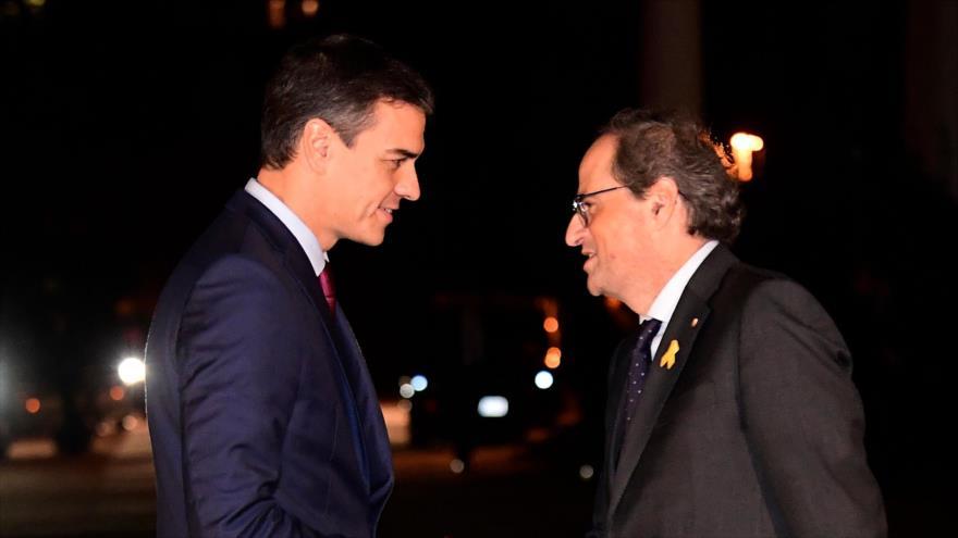Presidente catalán Quim Torra (dcha.) y el presidente en funciones del Gobierno español, Pedro Sánchez, 20 de diciembre de 2018. (Foto: AFP)
