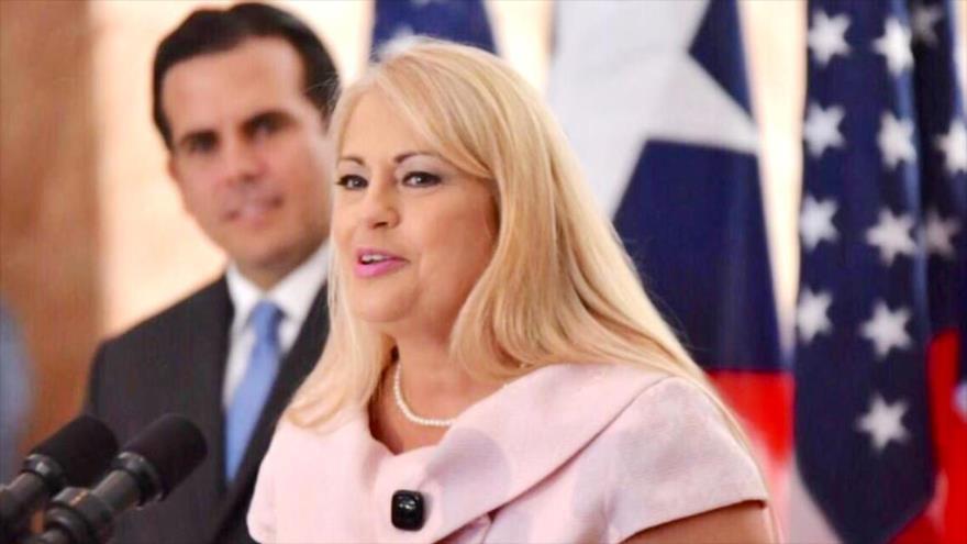 Wanda Vázquez, la secretaria de Justicia de Puerto Rico, y el gobernador saliente de la isla, Ricardo Rosselló.