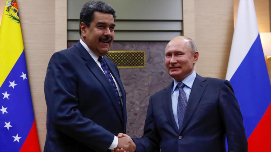El presidente ruso, Vladimir Putin (dcha.) y su par venezolano, Nicolás Maduro, en Novo Ogaryovo, cerca de Moscú, 5 de diciembre de 2018. (Foto: AFP)
