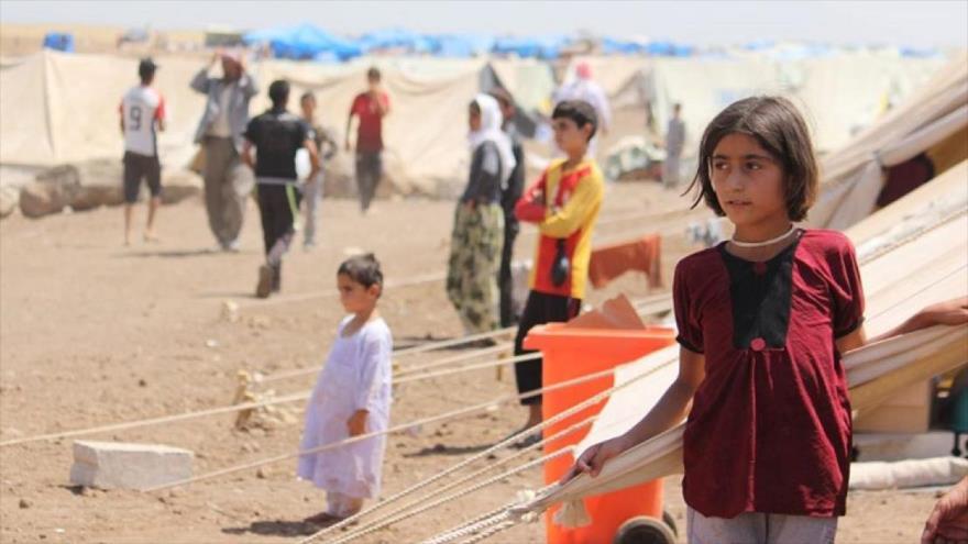 Desplazados de la minoría kurda izadí en un campamento de refugiados en el norte de Irak.