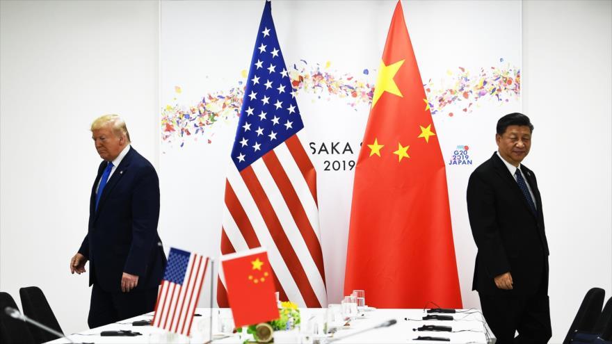 Los presidentes de China (dcha.) y EE.UU., Xi Jinping y Donald Trump, respectivamente, se reúnen al margen de la cumbre de G20 en Osaka, Japón, 29 de junio de 2019.