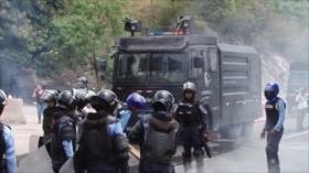 Policía hondureña reprime protestas contra Orlando Hernández