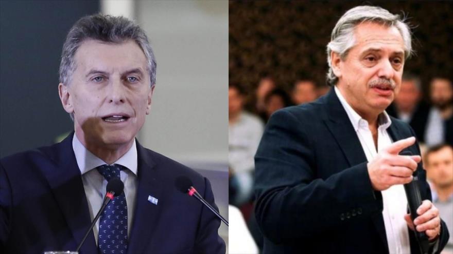 El candidato presidencial Alberto Fernández (dcha.), y el presidente de Argentina, Mauricio Macri.