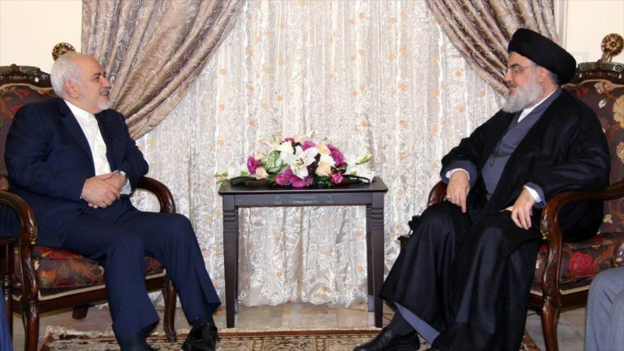 El líder del Movimiento de Resistencia Islámica de El Líbano (Hezbolá), Seyed Hasan Nasralá (dcha.), reunido con el canciller iraní, Mohamad Yavad Zarif.