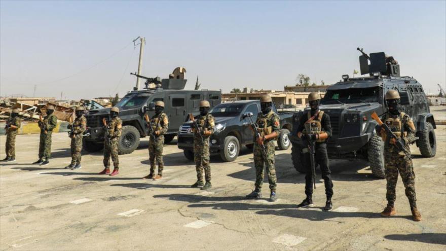 Combatientes de las llamadas Fuerzas Democráticas Sirias (FDS) en la ciudad de Hayin.