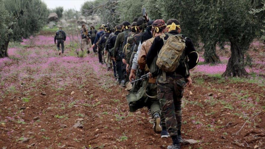 Los llamados rebeldes sirios en la aldea de Jalidiah en Afrin, Siria, 11 de marzo de 2018.