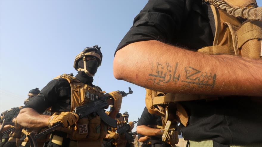 Miembros de las Unidades de Movilización Popular (Al-Hashad Al-Shabi, en árabe) de Irak en una maniobra militar, Basora, 31 de enero de 2019.