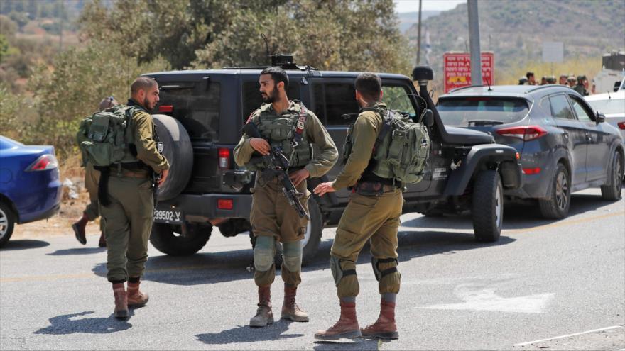 Militares israelíes estacionados cerca del asentamiento Dolev, en Cisjordania ocupada, 23 de agosto de 2019.