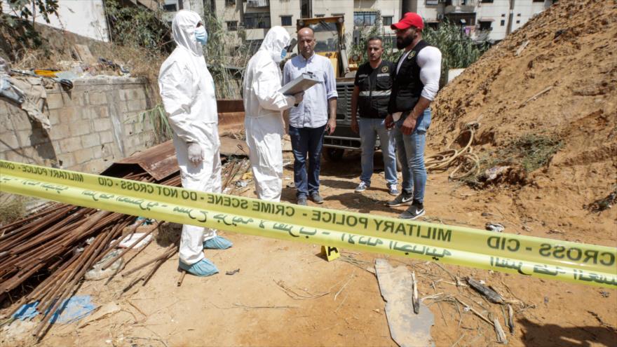 Investigadores forenses en el lugar donde cayeron dos drones israelíes en el sur de Beirut, capital de El Líbano, 25 de agosto de 2019. (Foto: AFP)