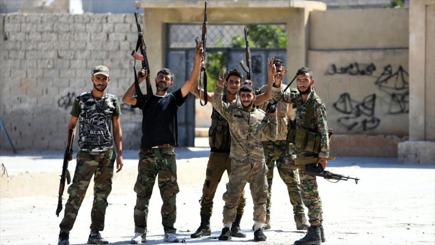 Los soldados del Ejército sirio en Jan Sheijun, en la provincia siria de Idlib, 23 de agosto de 2019. (Foto: AFP)