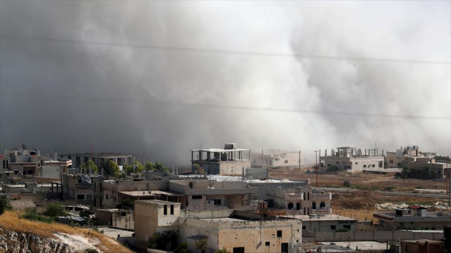 El Ejército sirio ataca con misiles una fortificación de terroristas en Jan Sheijun, en Idlib, 19 de julio de 2019. (Foto: AFP)