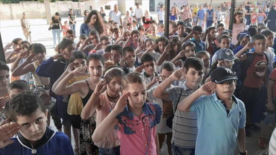 Estudiantes sirios festejan el inicio del año escolar en Latakia (oeste de Siria), 2 de septiembre de 2019. (Foto: SANA)
