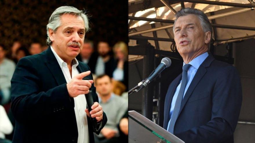 El precandidato a la Presidencia argentina Alberto Fernández (izda.), y el presidente actual Mauricio Macri, aspirante a un segundo mandato.