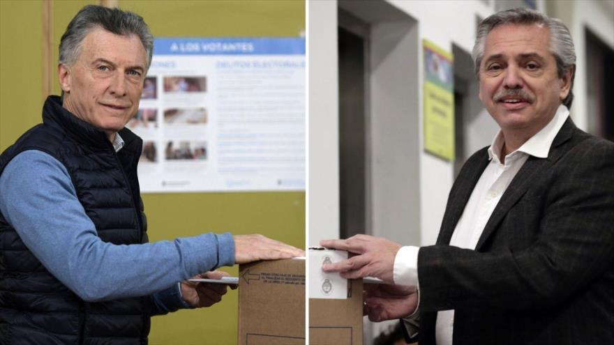 El presidente de Argentina, Mauricio Macri (izda.), y su rival electoral Alberto Fernández emiten su voto en las primarias, 11 de agosto de 2019.